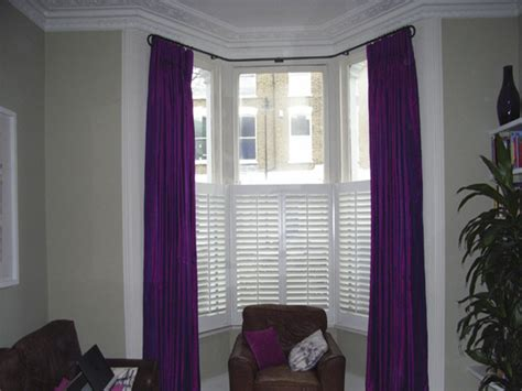 Bow Window Curtain Rods silk curtains interlined and pinch pleated on bay window