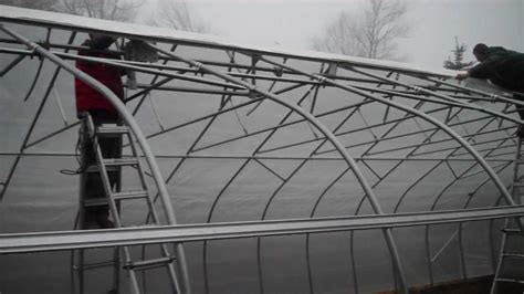 how do i build a greenhouse in my backyard how to build a greenhouse step 27 attaching poly to the