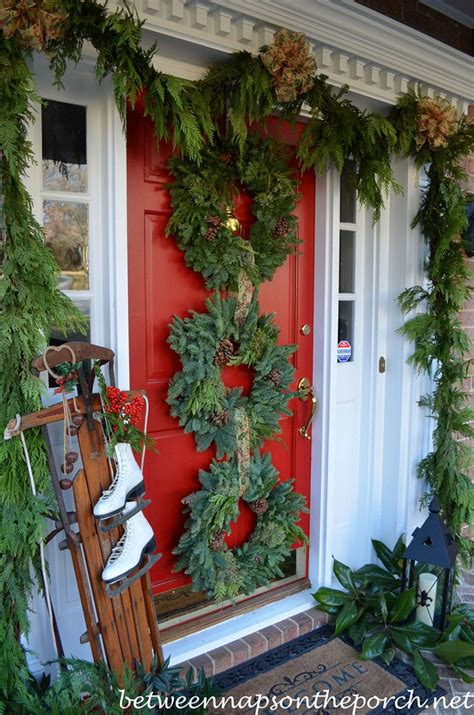 front door sled designs front porch decorated for with three wreaths on door and pottery barn knock garland