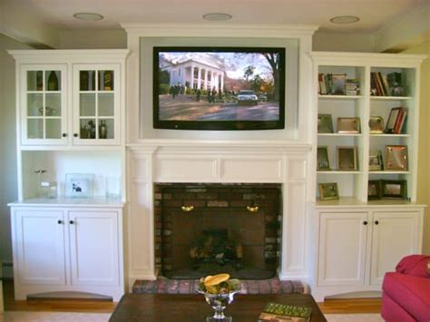 cabinet for tv over fireplace tv mounted above fireplace in custom cabinet with in