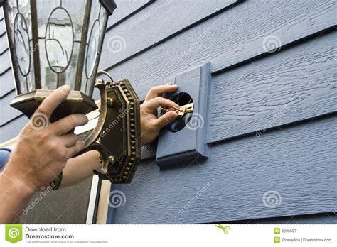 Fixing A Light Fixture Fixing A Light Fixture Royalty Free Stock Photography Image 6295567
