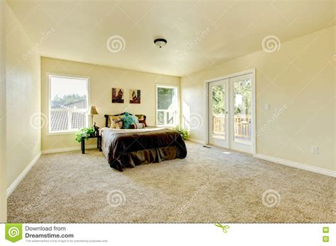 Gelang Simple Beigebrown and simple bedroom in tones with beige carpet stock image image of image clean