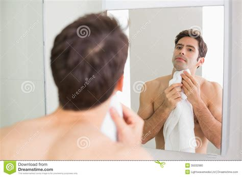 How To On Someone In The Bathroom by Looking At Self In Bathroom Mirror Stock Photo