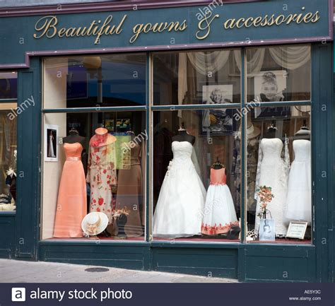 Wedding Dress Shop by Bridal Gown On Mannequin In Shop Window Display Stock