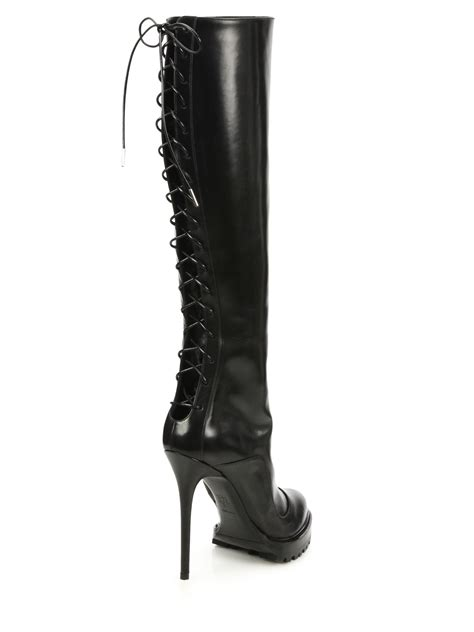 mcqueen lace up knee high leather boots in black