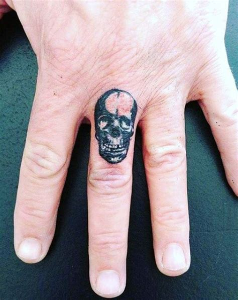 skull tattoo on finger 33 attractive finger tattoos for