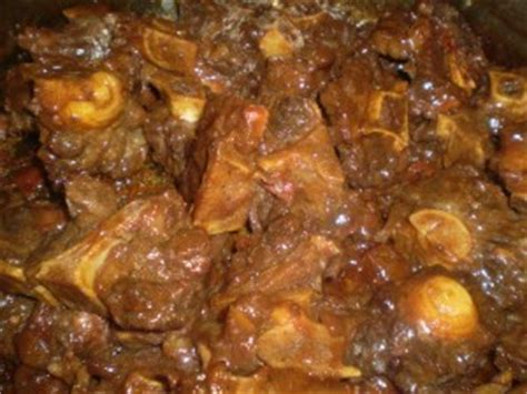 savory oxtail in a rich and thick gravy caribbeanpot com