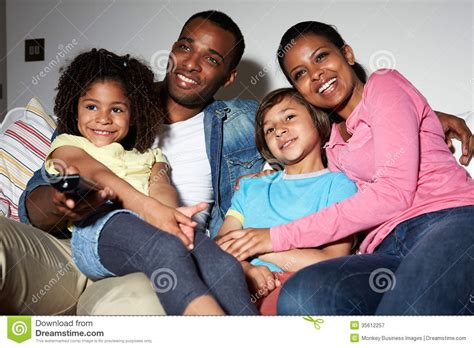 sofa for watching tv family sitting on sofa watching tv together stock image