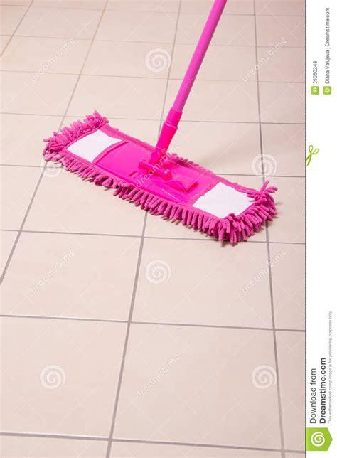 mopping bathroom floor mopping tile floor in light bathroom royalty free stock