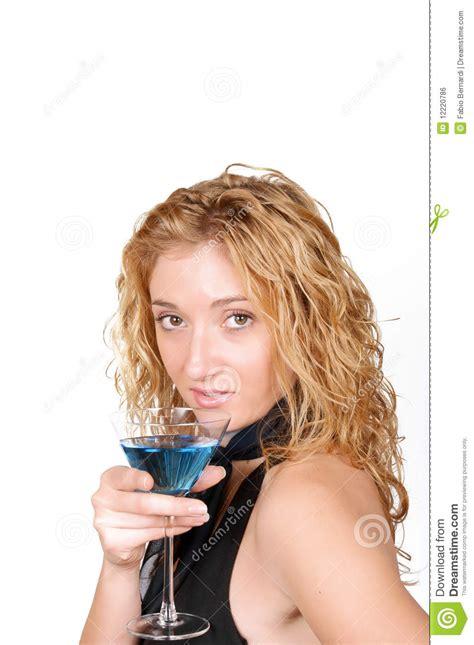 martini woman seductive young woman holding a martini glass stock photo