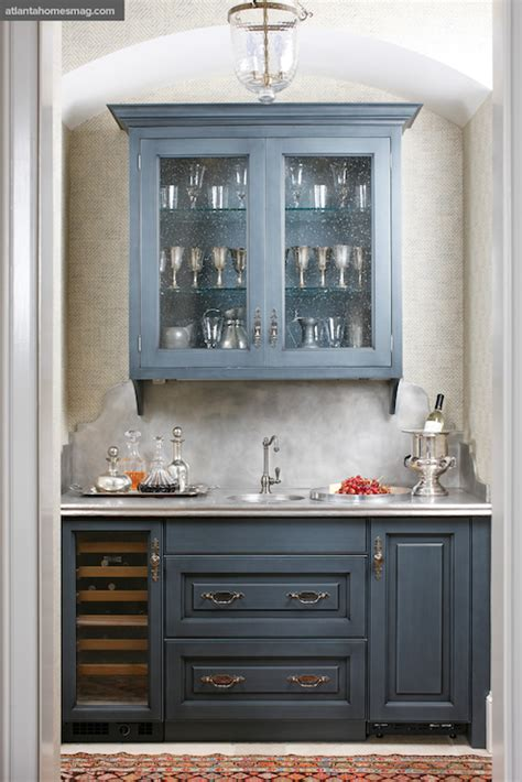 Cabinets and blue lower cabinets paired with gray countertop and