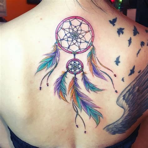 dream catcher tattoo with color the origin and meanings of the dreamcatcher tattoos