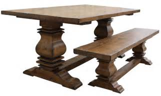 rectangular unstained woooden dining table with wooden pedestal on brown harwood floor with
