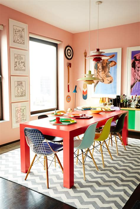 bold dining room colors meet the ceo who mixes bold colors like a and poses like natch eames chairs
