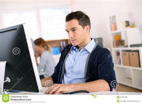 front desk jobs for 16 year olds man working in office stock photo image of casual worker