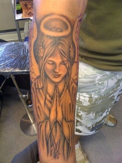 tattoo angel in hand hand angel wings tattoo tattoomagz