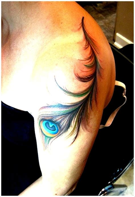 feather tattoo on girl s arm 40 peacock feather tattoos for girls