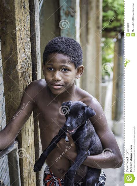 city boy wit it unidentified boy wit a dog in favela slums in rio de
