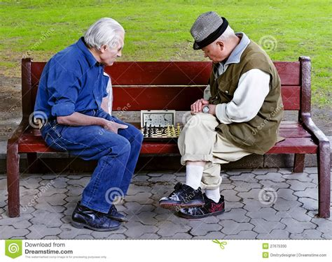 old people on a bench older people play chess on a bench editorial image image