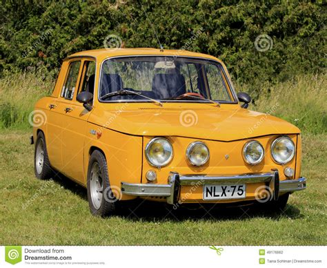 renault yellow yellow renault 8s car parked on grass editorial