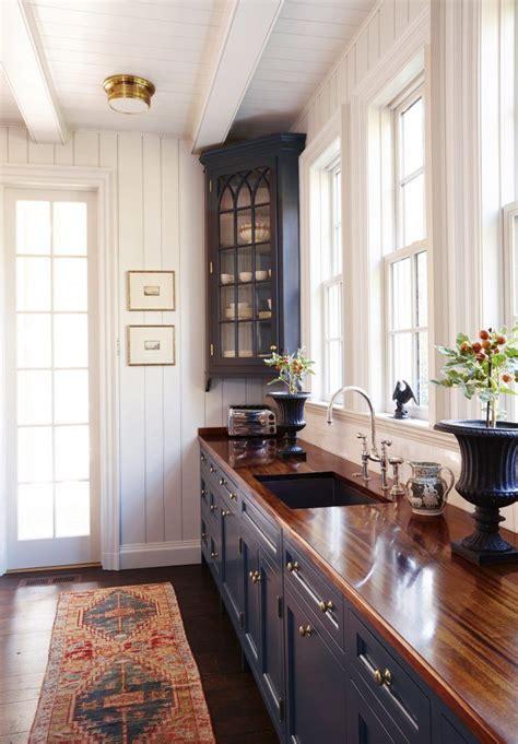 colonial kitchen butcher block counters dark cabinets