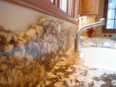 detail of chiseled granite backsplash stocker tile
