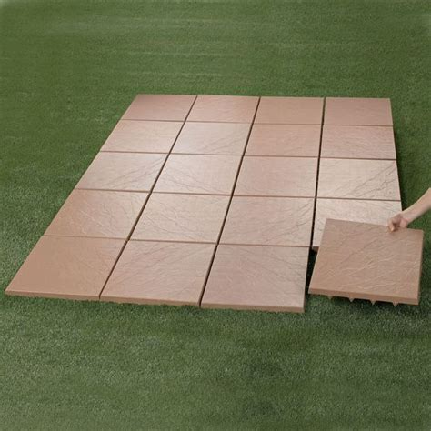 lightweight patio stones create an instant patio on any grass dirt or sand surface ultra lightweight tiles spiked