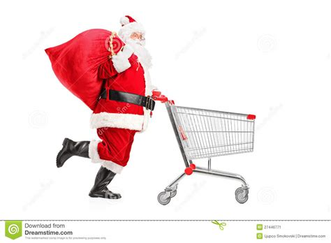 santa claus with a bag pushing a shopping cart stock image