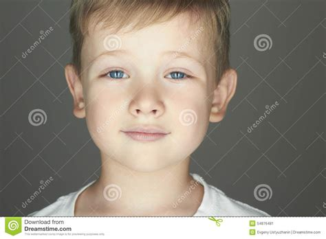 funny small funny little child holding big cup with snowflakes and