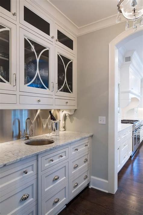 kitchen cabinet shells chic butler s pantry boasts white drawers adorned with