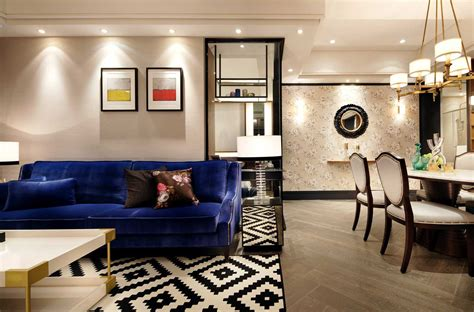 best small apartment living room designs with geometric patterned area rug and blue sofa artenzo