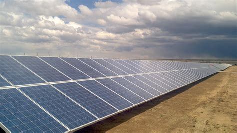 solar panels about official investing in a south solar project