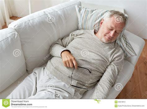 comfort man senior man sleeping on sofa at home stock photo image