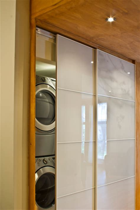 laundry room sliding doors time home owners contemporary laundry room montreal by emily cbell