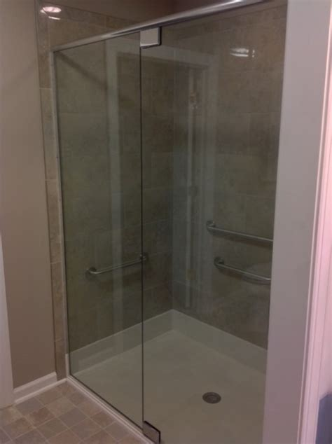 Used Shower Doors Pivot Hinges With Heavy Header Used In This Frameless Shower Door And Panel Enclosure