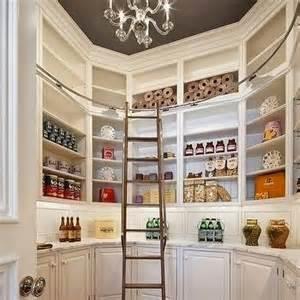 Incredible walk in pantry with dark gray painted octagonal recessed