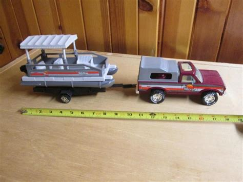 toy boat with trailer nylint sun tracker truck w cer shell pontoon boat