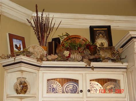 above cabinet decor 42 best decor above kitchen cabinets images on pinterest