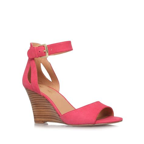 pink mid heel sandals nine west floyd mid heel wedge sandals in pink lyst