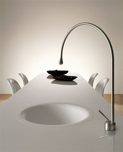 goccia kitchen faucet by gessi is built into the dining table