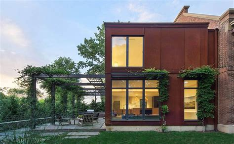 Gambrel Roof House cor ten steel structure gives georgian revival home a