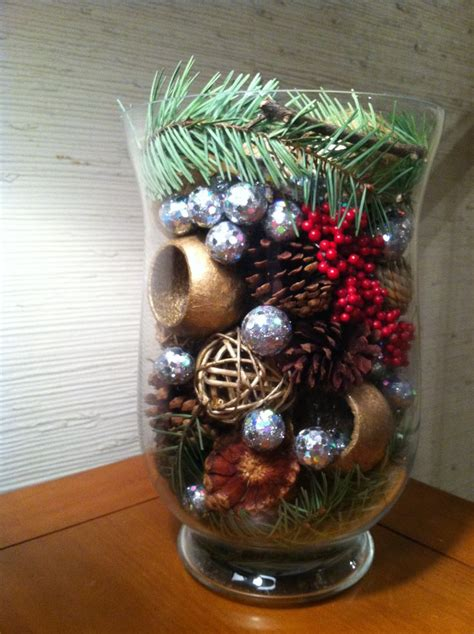 christmas decor made with pine tree branches pine cones
