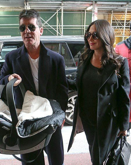 simon cowell and lauren silverman leave baby eric at home simon cowell and lauren silverman beam as they leave new