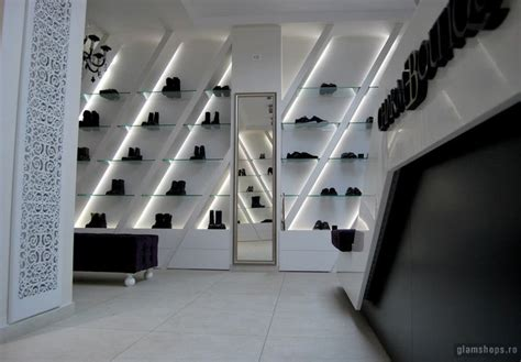 pattern wall display charme luxury shoe boutique bucharest store design