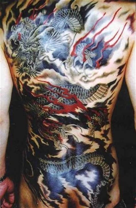 japanese dragon flying in sky tattoo on back
