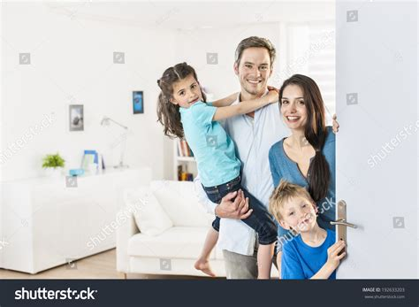 family standing front door invite stock photo