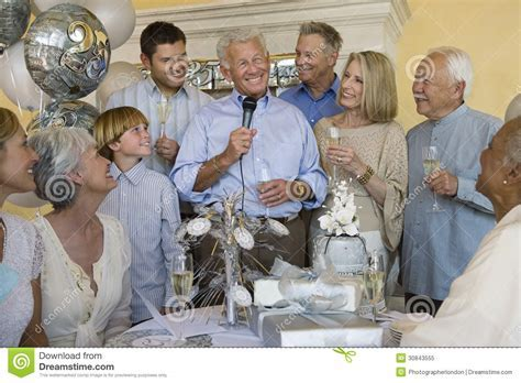 Senior Man Celebrating Retirement With Family And Friends