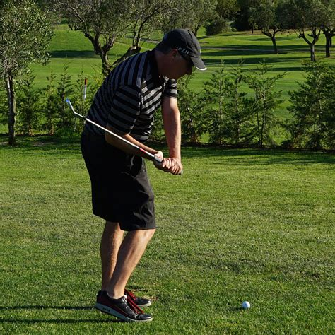 trying swinging how to eliminate early extension in your golf swing golf
