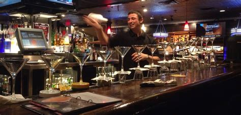 flair at tgi friday s shows bartenders skills while raising money for hunger relief
