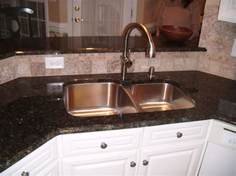 similar layout with backsplash the sink and a
